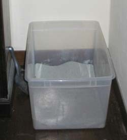 Large, uncovered storage boxes make perfect litter boxes for cats.